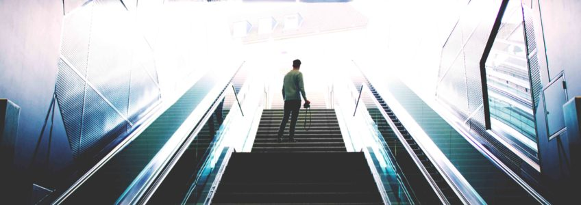 A man standing on the stairs, ready to take action towards his goal.